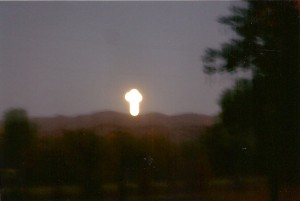 A sun cross on the mountain on the full moon.